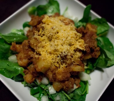 Chorizo Potato Smash Over Spinach Salad