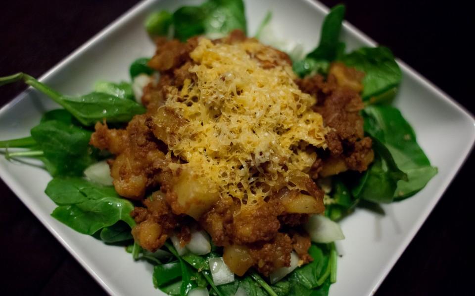 Chorizo Potato Smash Over Spinach Salad